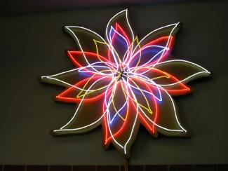 'Nightblooming Flower' Neon sculpture ø 225cm, 7 Transformators red, white, blue, yellow ,4 animated circuits, 1998